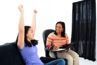 happy female teen with arms raised